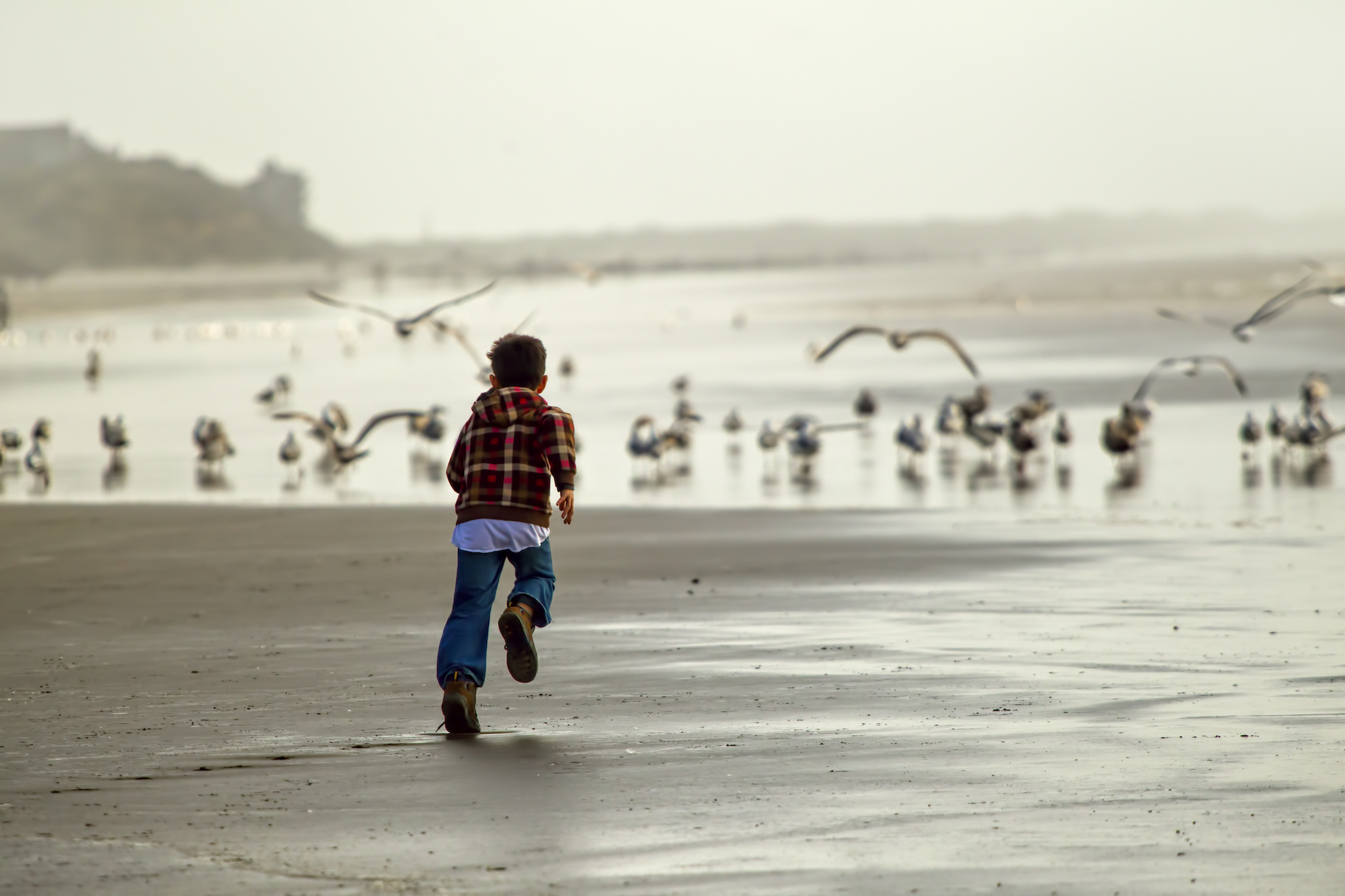 A child runs along the coast near Newport, Oregon.